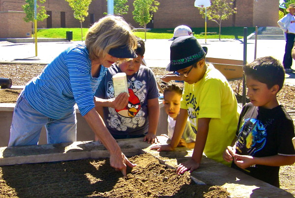 2012 - Samuels - Kathy Planting with Youth (Pallas Quist)