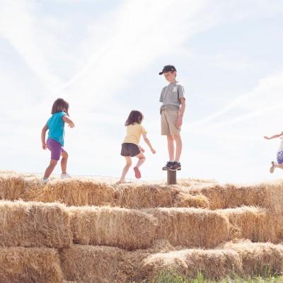 2012 - DeLaney - Youth running on straw bales