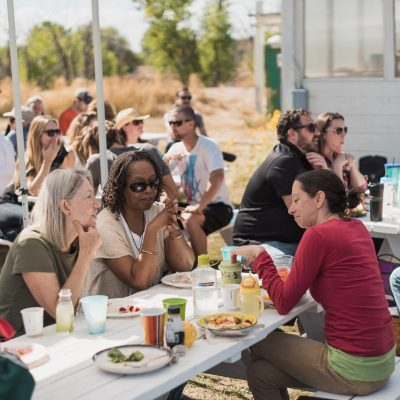 2016 - Brunch in the Field - Happy people at picnic tables
