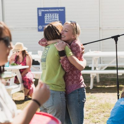2016 - Brunch in the Field - Heather and Erika hugging